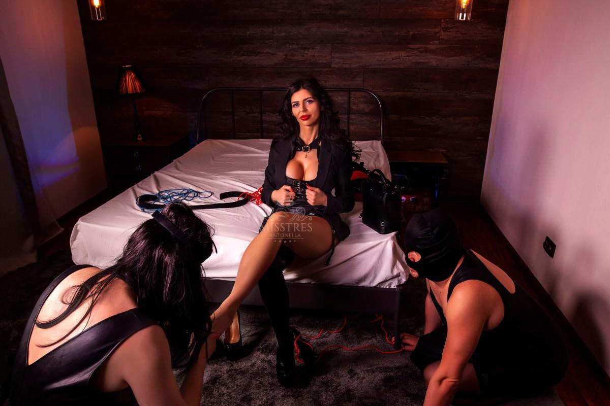 sissy-male-slaves-licking-mistress-antonella-feet