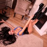 mistress antonella laying on the floor with black long boots