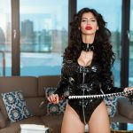mistress antonella in black leather suit in the penthouse