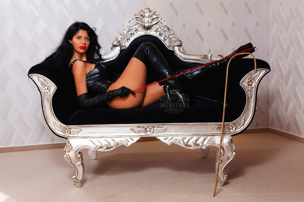 Mistress Antonella on a white vintage couch